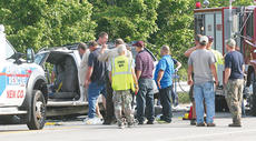 "<div class=""source""></div><div class=""image-desc"">Owen County emergency workers and firefighters survey the scene after the crash that left Owen County Emergency Management Director Rick Morgan injured.    </div><div class=""buy-pic""><a href=""/photo_select/12077"">Buy this photo</a></div>"