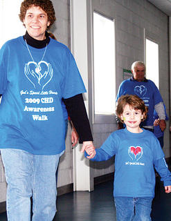 Congenital heart-defect survivor Kyser Bottoms walks with her mom, Kenda Franks, during the fifth-annual congenital heart-defect walk.