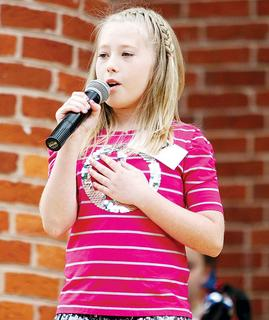 The annual talent show gave many aspiring singers the chance to perform in front of the community.
