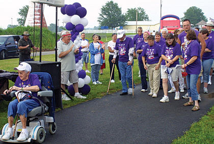 With Lenora Kelly Olds leading the way, cancer survivors took the first lap in the 2010 Owen County Relay for Life.