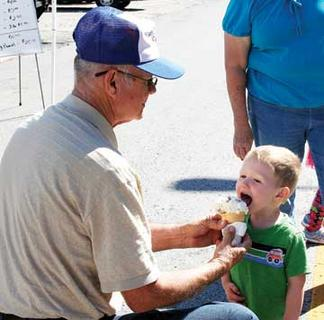 Gary Coley shares his ice cream with Bennett Coley.