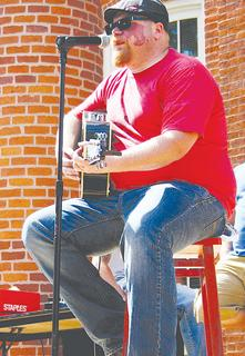 Puddin Howell entertains in front of the courthouse Saturday as part of the annual Sweet Owen Day festival.