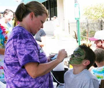 Holly Bowling shares her talent for face painting on Brandon Lewis.