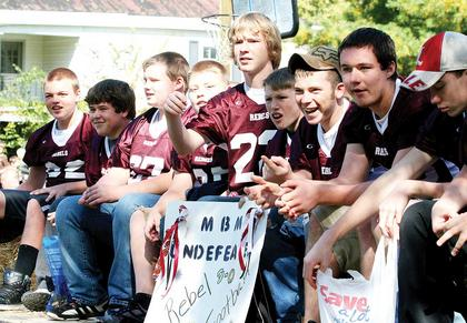 The members of the Maurice Bowling Middle School football team rode in the Monterey Homecoming Fair Saturday through the streets of town.