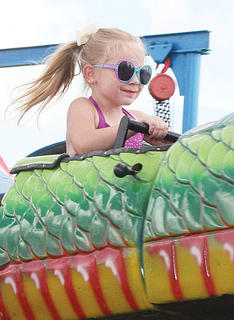 Zoe Chaney, 5, enjoys a ride on the opening day for the rides of this year's 4-H fair and horse show.