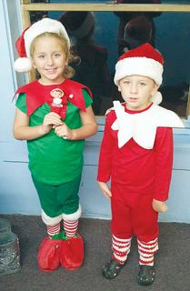 "Kaileigh Grider, 7, as Freda the Elf,"" and James Grider, 6, as ""Fred the Elf"" from their favorite book, ""The Elf on the Shelf."""