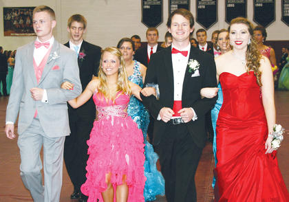 Cooper Taylor, Ashley Smith, Mitchell Griffin and Hannah Strohmeier show off their prom getups. Bottom: