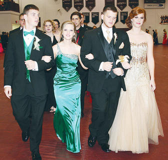 Collin Trammel, Felicia Perkins, Jared Fitzgerald and Andi Wash take a stroll down the high-school gymnasium.
