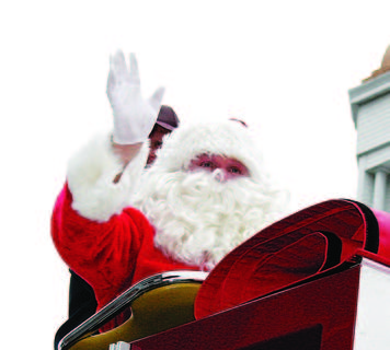 Despite Sunday's dreary weather, Santa Claus made his way through downtown Owenton to visit with the community.