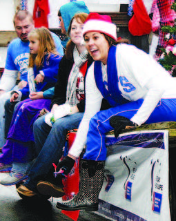 Shanna Osborne and Jodi Dunavent ride the Relay For Life float and toss candy to parade-goers.