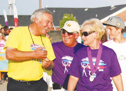 Gilbert England talks with other volunteers at this year&#039;s Relay for Life.