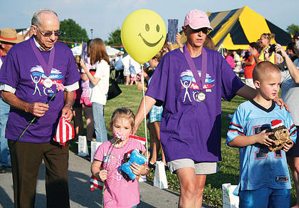 Cancer survivor Bro. Jesse Bourne, left, walks with Allie Sharon, Teresa Sharon and Jeremiah Sharon