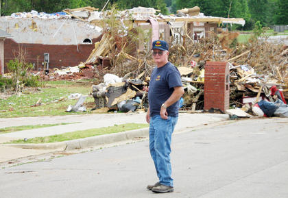 After dropping off the donations, truck driver and one of the main organizers of the donation drive, Danny Cook, surveys some of the damage caused by a series of tornadoes in Alabama earlier this month.
