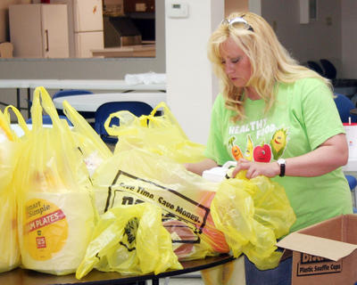 Lucinda Renfro sorts supplies that will be delivered to tornado victims in Alabama.