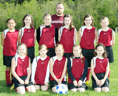 "Back row: Coach Eric Gordon ""Coach Dude""; Middle row (left to right): Maria Bolanos, Meagan Bruener, Grace Chilton, Marissa Craig, Autumn Bolen, Paige Heuser; Front row (left to right): Hailey Chamberlin, Allie Burford, Hailee Gordon, Debbie Richey, Lauren McDonald"