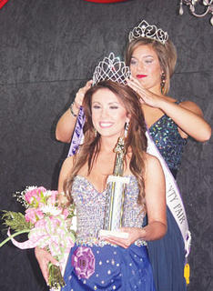 2013 Miss Owen County Fair Courtney Waldrop crowns the 2014 Miss Owen County Brittany Clark.