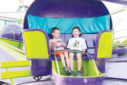 Colby Bramblett and Clayton Allnut enjoy their time on the tilt-a-whirl.