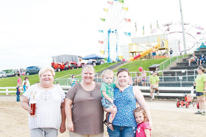 "The family with the most generations present, recognized as ""The Fair Family."" From left to right: Mary Kay Duncan, Regina Beattey, Katy Stewart with Gunnar and Presley."