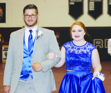 Clay Beverly and Sarah Shockley make their way down the court.