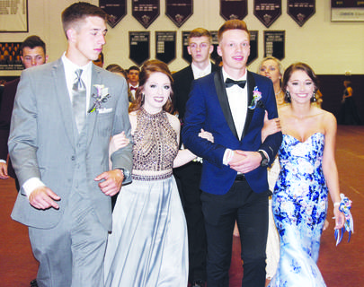 Chris Sutton, Autumn Maddox, Patrick Osborne and Kylee Robinson show off their formal attire at the school's annual grand march.