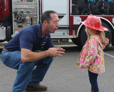 Assistant Owenton Fire Chief Jude Canchola chats with Livie Glass.