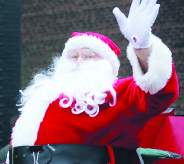 Santa Claus makes his annual appearance in the Owenton Christmas Parade Dec. 4.