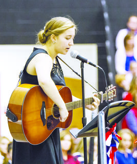 "OCHS student Allison Burford performs ""Two Soldiers Coming Home"" at Friday's Veterans Day celebration."