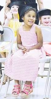 Owen County Lower Elementary School held its kindergarten graduation May 25. Above: Alena Lindsey awaits her Kindergarten gradation.