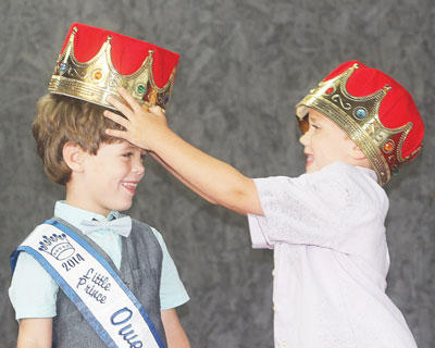 Carter Hopperton was crowned 2014 Little Prince by 2013 Little Prince, Conner Dezarn.