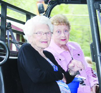 104-year-old Lucy Hall rides in Saturday's parade with Shirley Luther