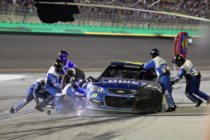 Jimmie Johnson makes a pit stop late in the race Saturday.