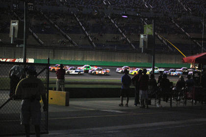 Fans watch as the trucks take the green flag for a restart during the Thursday night truck race.