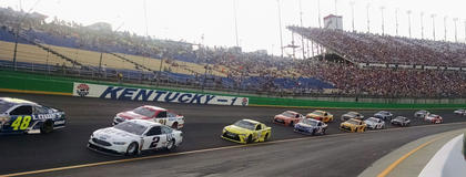 Sprint Cup cars head down into the newly reconfigured, 17-degree banked turn one on Saturday.