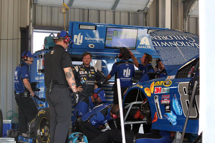Crews for the No. 88 Chevrolet, driven by Dale Earnhardt Jr. (pictured), work on the race car.