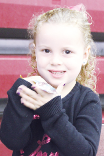 Kyrra Dempsey shows off an ornament she made at the event's Kids Zone.