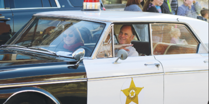 Richard and Vicki Greene ride up Seminary Street in a replica of Sheriff Andy Taylor's squad car during Sunday's parade. Richard Greene began the Mayberry Day event held each June on the courthouse square in 2014. For more photos from Sunday's parade, please see page 2.
