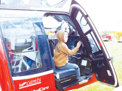 Levi Young checks out the controls inside the Air Evac helicopter out of Williamstown.