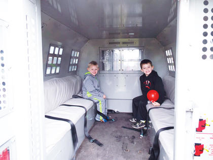 Logan and Kayden Groves check out the back of the Owen County Jailer's van.