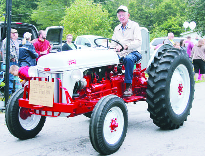 Wilber Perkins takes his 1952 Ford tractor for a spin in the parade.