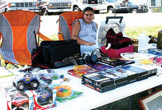 """<div class=""""source""""></div><div class=""""image-desc"""">From Alabama to Michigan  The annual 127 Yard Sale runs over 600 miles and brings thousands of shoppers and vendors to Owen County in Although the sale doesn't formally begin until Thursday, many vendors like Jenny Alexander have already set up shop. Left: </div><div class=""""buy-pic""""><a href=""""/photo_select/5494"""">Buy this photo</a></div>"""