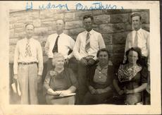 "<div class=""source"">Family Photo</div><div class=""image-desc"">L-R, front row: My grandmother Monnie Hudson, Aunt Elizabeth Hudson, Aunt Bessie Hudson. Back Row: Uncle Bert Hudson, my grandfather George Hudson, Uncle Dick Hudson, Uncle Murf Hudson. </div><div class=""buy-pic""></div>"