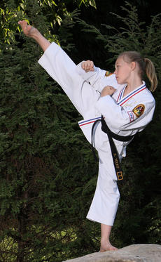 "<div class=""source""></div><div class=""image-desc"">Kendall Yount shows off some of her moves. Yount, who recently turned 11, has competed across the United States and recently placed in the top 10 in her age category.</div><div class=""buy-pic""><a href=""http://web2.lcni5.com/cgi-bin/c2newbuyphoto.cgi?pub=033&orig=506_maple_%2526_kendall.jpg"" target=""_new"">Buy this photo</a></div>"
