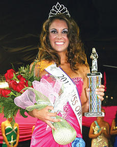 "<div class=""source"">Molly Haines</div><div class=""image-desc"">Danielle Hoop stops for pictures after being crowned Miss Owen County Fair 2012</div><div class=""buy-pic""><a href=""/photo_select/7618"">Buy this photo</a></div>"