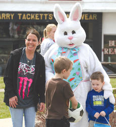 "<div class=""source"">Molly Haines</div><div class=""image-desc"">Adults and kids alike stopped to enjoy some time with the Easter bunny on the courthouse lawn Saturday.</div><div class=""buy-pic""><a href=""/photo_select/9130"">Buy this photo</a></div>"