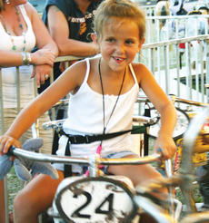 "<div class=""source""></div><div class=""image-desc"">Ellie Anderson enjoys the first night of the Owen County 4-H Fair and Horse Show with a ride to cool her off.</div><div class=""buy-pic""><a href=""/photo_select/7620"">Buy this photo</a></div>"