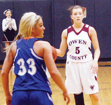"<div class=""source"">Photo by Brian Blair</div><div class=""image-desc"">Owen County's Rianna Gayheart plots her next move against Walton-Verona.</div><div class=""buy-pic""><a href=""/photo_select/6880"">Buy this photo</a></div>"