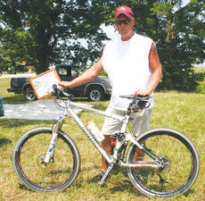 """<div class=""""source""""></div><div class=""""image-desc"""">Last year, Owen countian Greg Estes made national news when he purchased a bicycle once owned by professional cyclist and Tour De France champion Floyd Landis. The bike was purchased in Owenton for $5 and later sold on eBay for a huge profit. </div><div class=""""buy-pic""""><a href=""""/photo_select/5495"""">Buy this photo</a></div>"""
