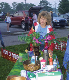 "<div class=""source""></div><div class=""image-desc"">Theresa Swiggert, a team-member of Sisters' Act, works on some of the details for the campsite competition.</div><div class=""buy-pic""><a href=""/photo_select/2482"">Buy this photo</a></div>"