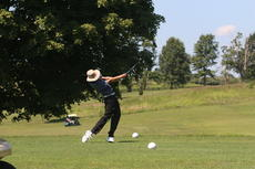 """<div class=""""source"""">Photos by Kristin Beck/Landmark News Service</div><div class=""""image-desc"""">The Owen County Rebels golf team participated in the Eighth Region All 'A' Tournament Thursday at Fairway Golf Course in Wheatley. The Carroll County Panthers won the tournament with a team score of 327.</div><div class=""""buy-pic""""><a href=""""/photo_select/16854"""">Buy this photo</a></div>"""