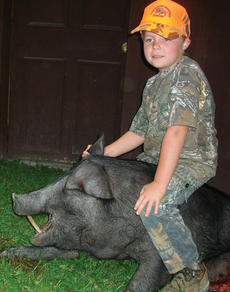 "<div class=""source"">Submitted</div><div class=""image-desc"">Canna Eades, the 7-year-old son of Robert and Tina Eades of Owenton, killed a 300 lb. wild boar while hunting with his father on his birthday Aug. 3 in Crossville, Tenn. </div><div class=""buy-pic""><a href=""/photo_select/10625"">Buy this photo</a></div>"